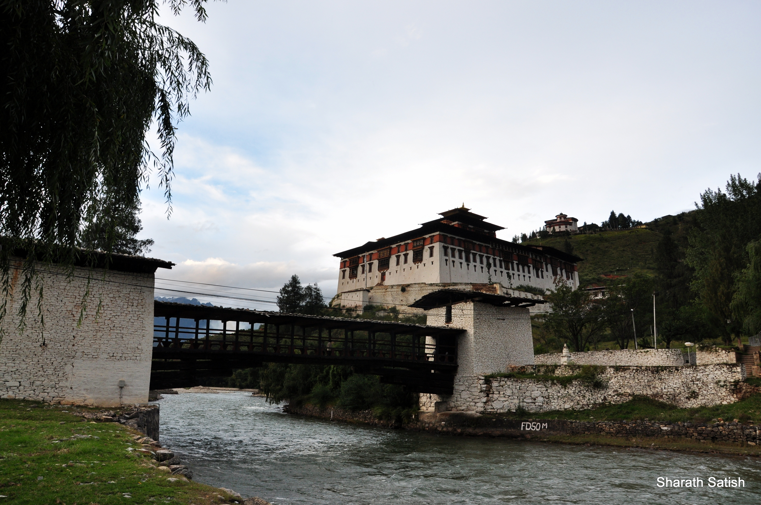 The bridge leading to it and the Rinpung Dzong (National Museum also visible at the back)