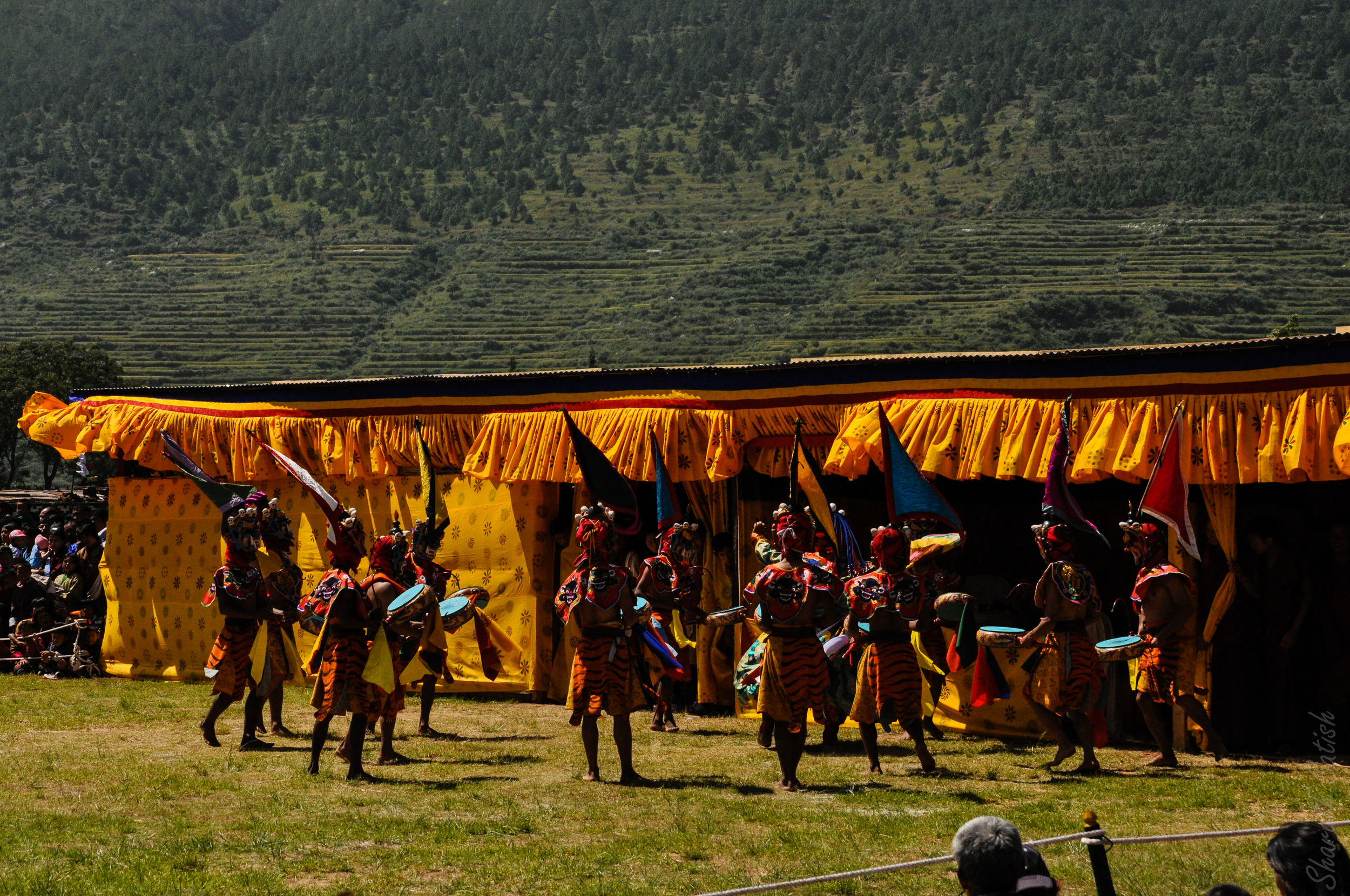 Dancers take the stage to perform as part of the opening Tsechu