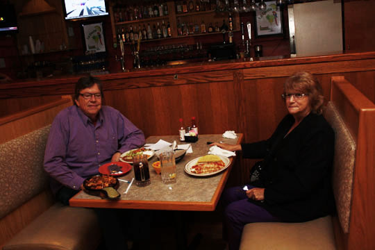 """The Author of this post, Bob """"The Whale"""" Miller and his wife Sue, settling in at a booth at La Siesta."""