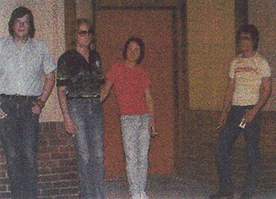 The band standing in front of The Emporium in Peoria Heights in 1979.