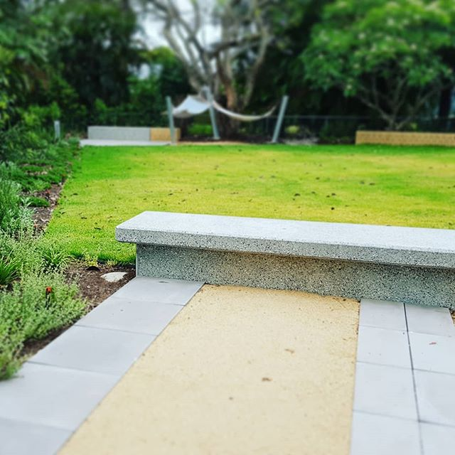 Concrete bench in garden #seedlandscapedesign #structureinlandscape