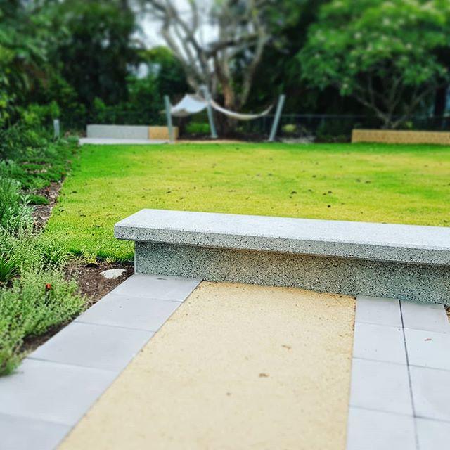 Concrete bench in garden #seedlandscapedesign #structureinlandscape