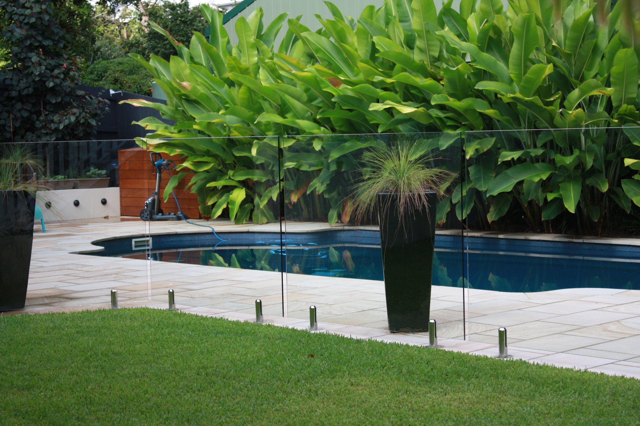 Broad-leafed plants soften the pool surrounds.