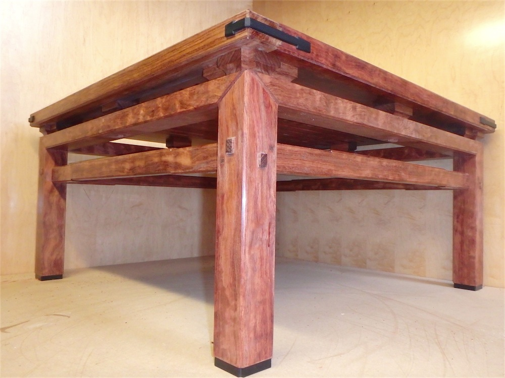 Coffee table in bubinga with ebony joinery detail on the corner.