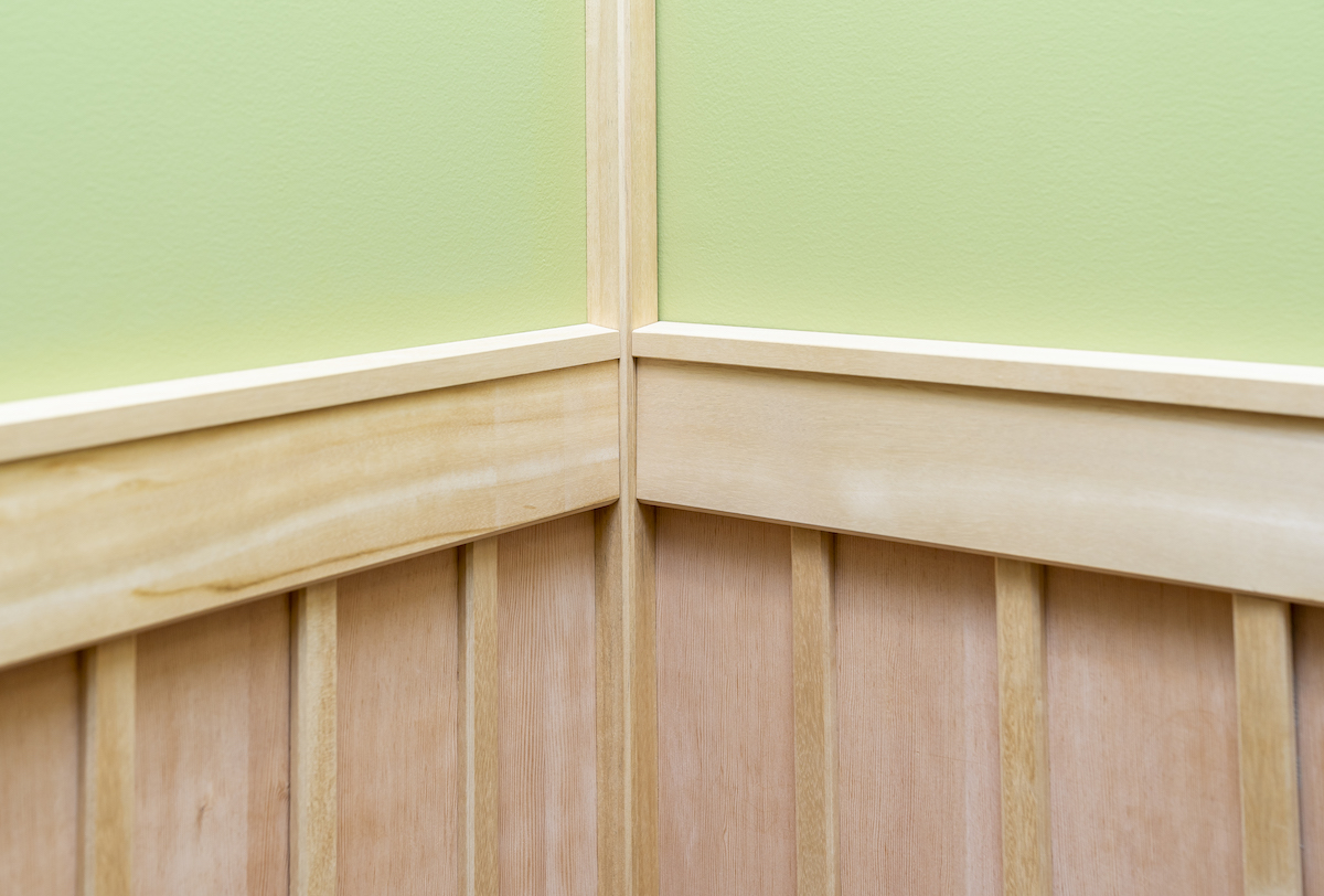 Wainscot lines a portion of the walls in the Japanese Room.