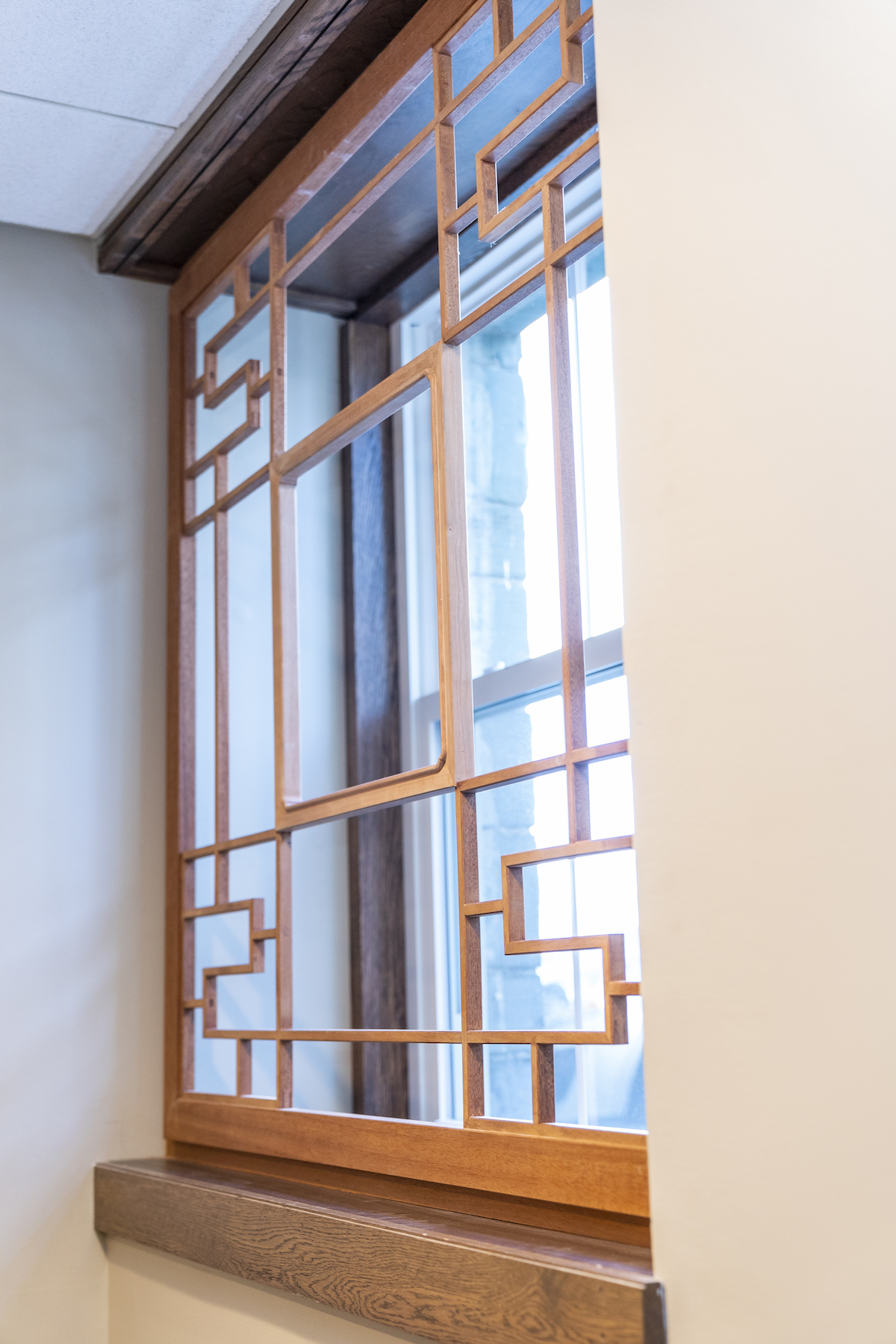 Mahogany outer frame and lattice, with American Black Cherry inner window frame.