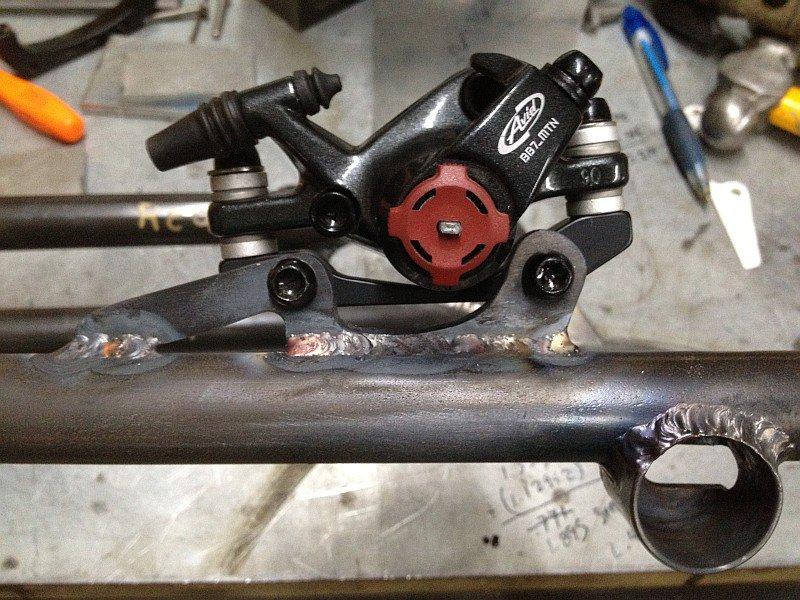2012-07-25 brake tab welded on streamliner fork stanchion.jpg