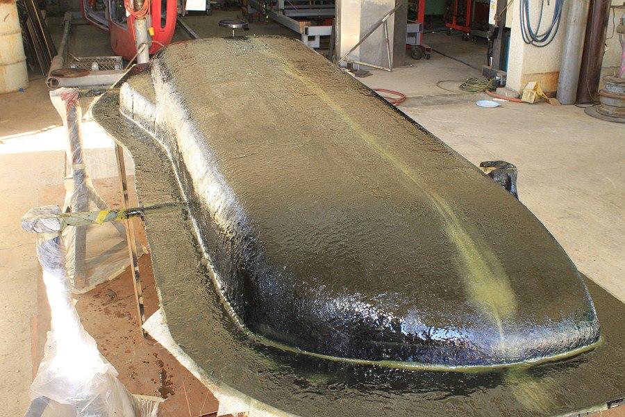 2012-08-27 17 body tooling 1st layup 1 ounce fiberglass mat.jpg