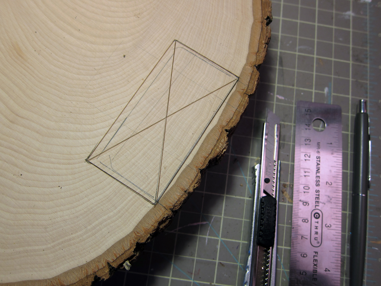 Make a chisel guide, slightly bigger than the tracing, using a utility knife and ruler.
