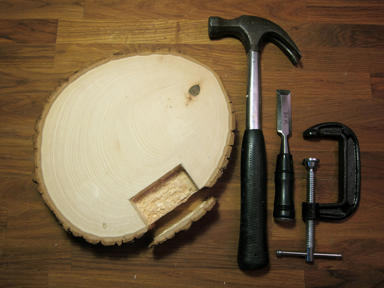 Clamp basswood round to work surface. With a wood chisel and hammer, carefully chisel off the bark edge of basswood next to the tracing marks. Put the bark piece aside.