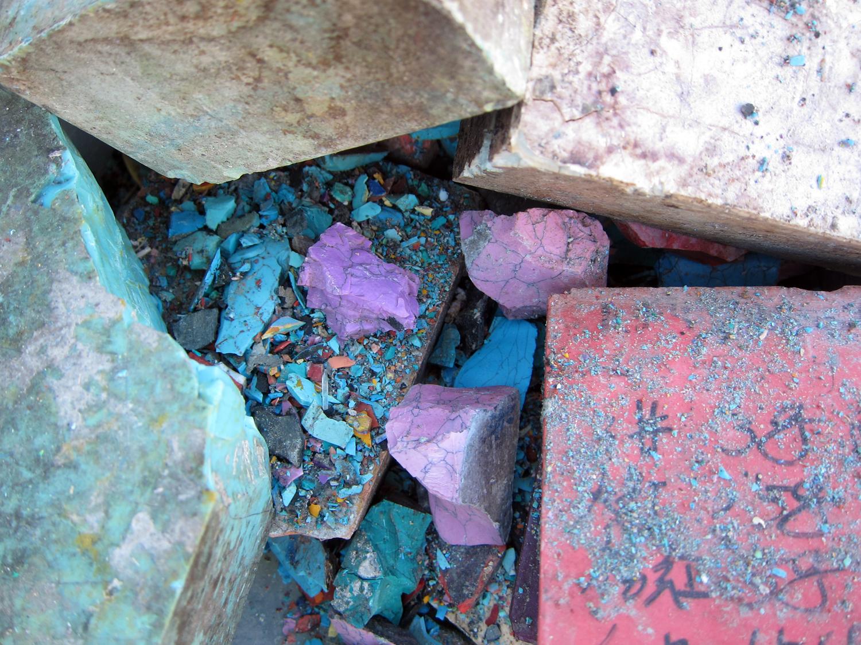 Broken bricks—chromatic pieces, vivid dust.