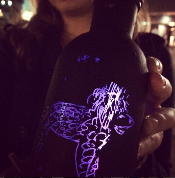 The bottles are coated with a special paint that scratches away to reveal the light beneath and, of course, the art.