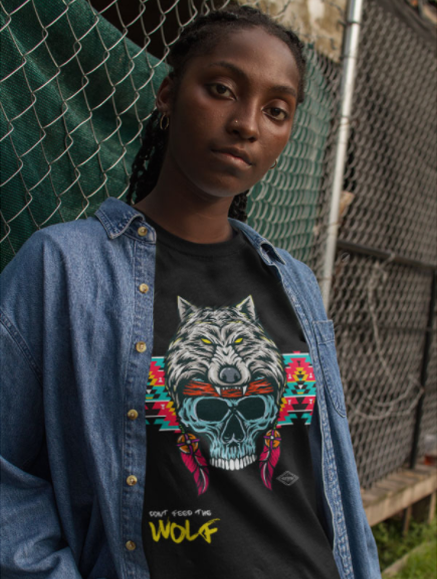 Placeit   Urban Portrait of a Black Girl Wearing a Round Neck Tee Mockup and a Denim Jacket Against a Fence.png