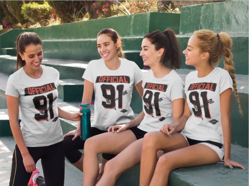 Group of Four Girls Hanging out and Wearing Different T Shirts Mockup While on Green Steps.png