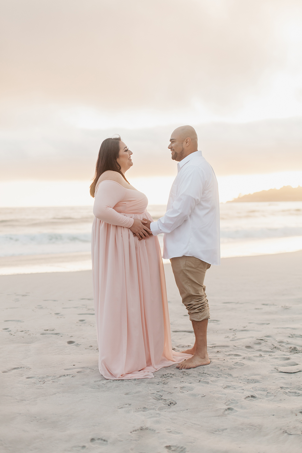 Husband and wife standing together during the maternity photo session at Carmel-by-the-sea.