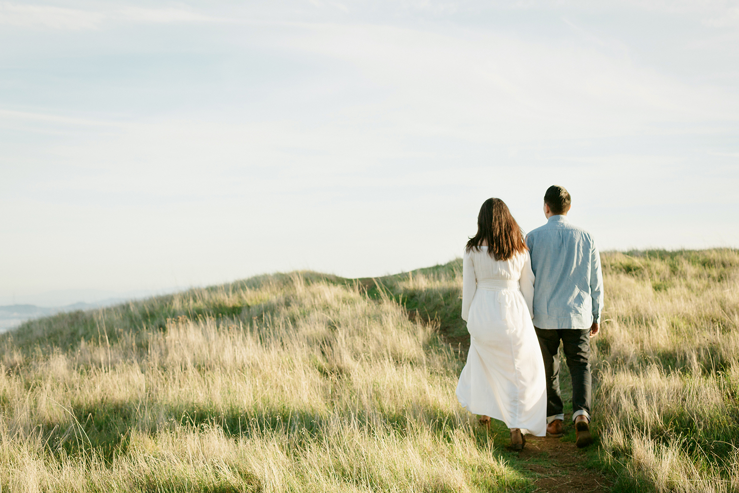 Couple walking together during their engagement session in Mount Tamalpais in Marin, California.
