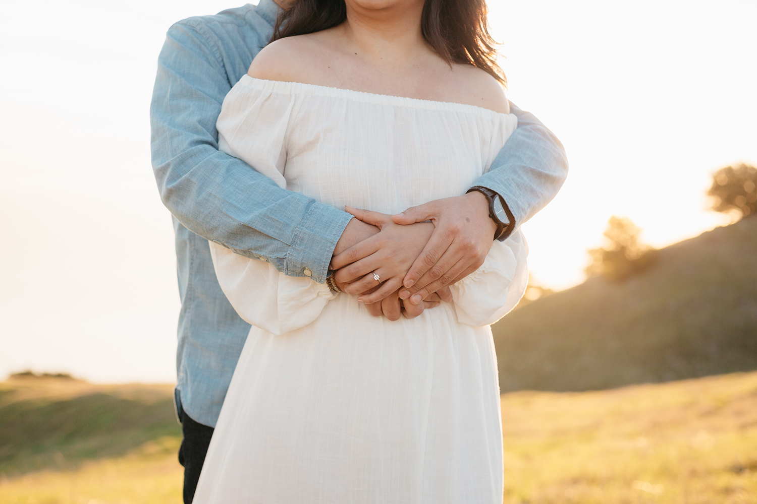 Couple hugging during their sunset engagement session in Mount Tamalpais in Marin, California.