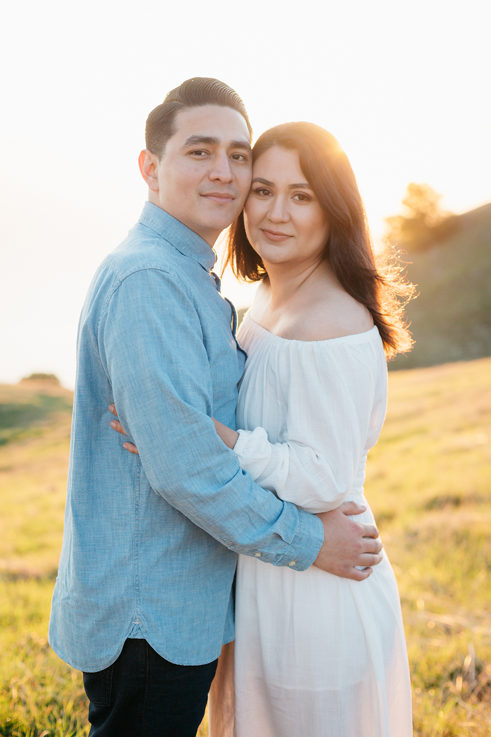 Portrait of couple during their sunset engagement session in Mount Tamalpais in Marin, California.