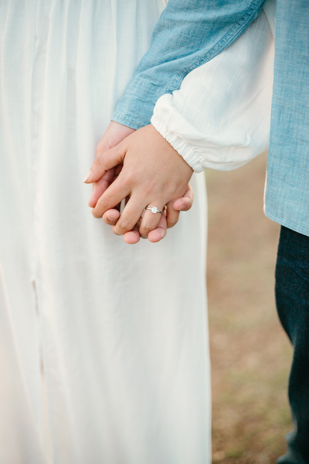 Couple holding hands during their engagement session in Mount Tamalpais in Marin, California.