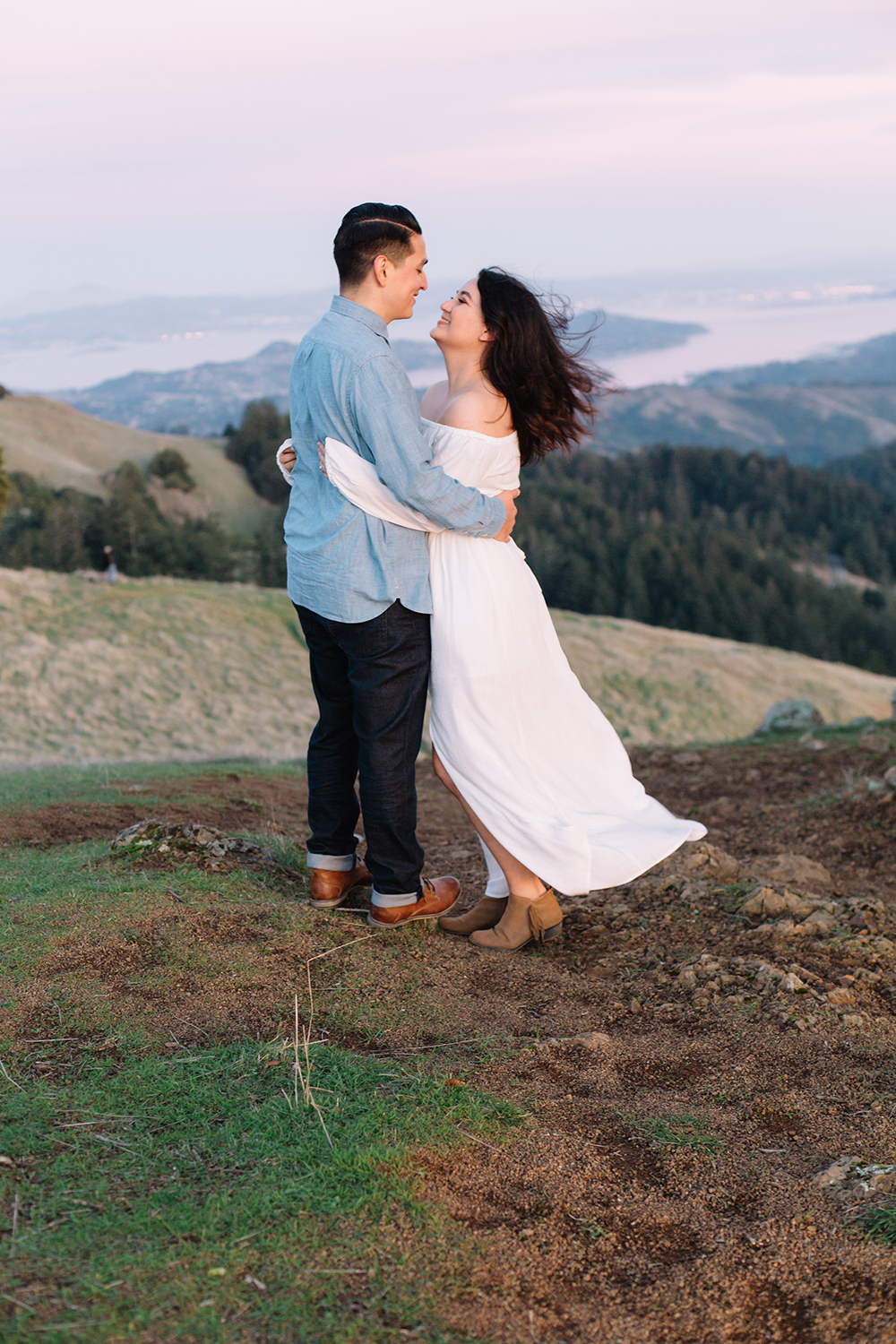 Couple smiling at eachother during their engagement session in Mount Tamalpais in Marin, California.
