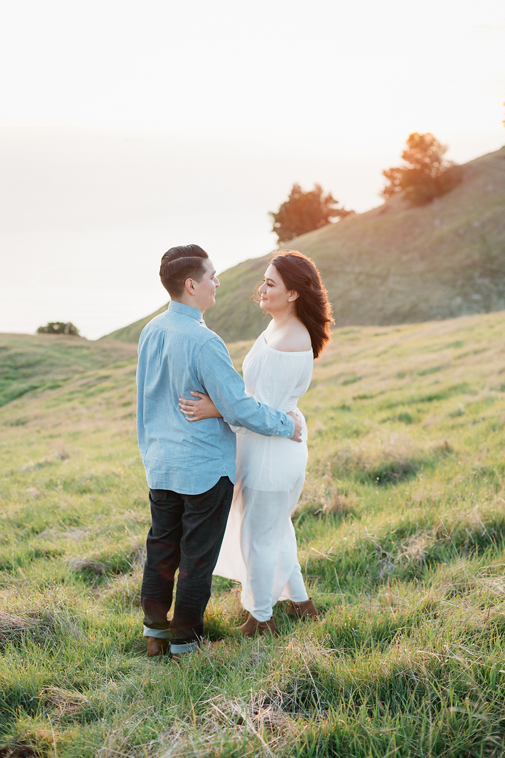 Couple at golden hour during their engagement session in Mount Tamalpais in Marin, California.