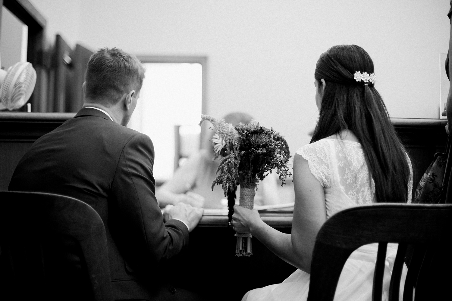 Bride and groom waiting to be married in San Francisco City Hall.
