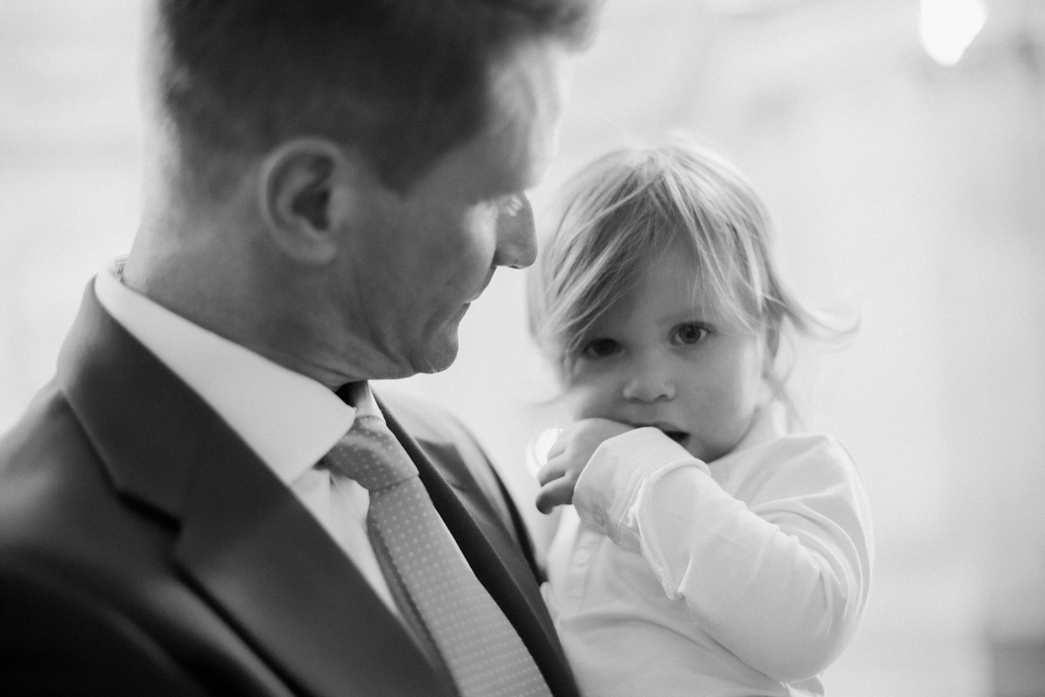 Groom and son during wedding in San Francisco City Hall.