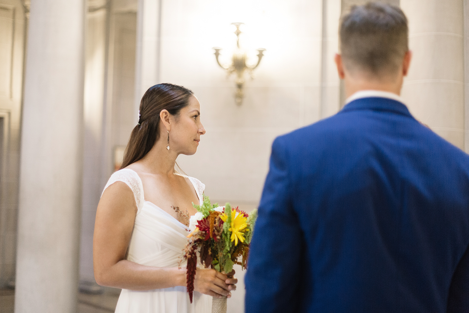 Bride and groom during their ceremony in San Francisco City Hall.
