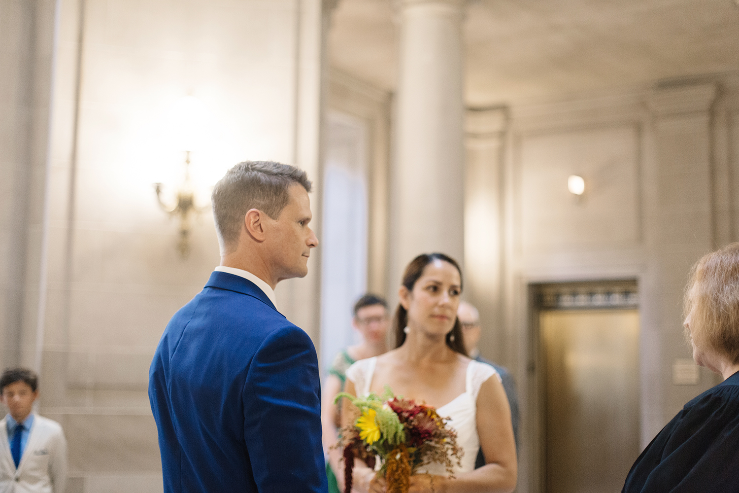 Bride and groom during their wedding ceremony in San Francisco City Hall.