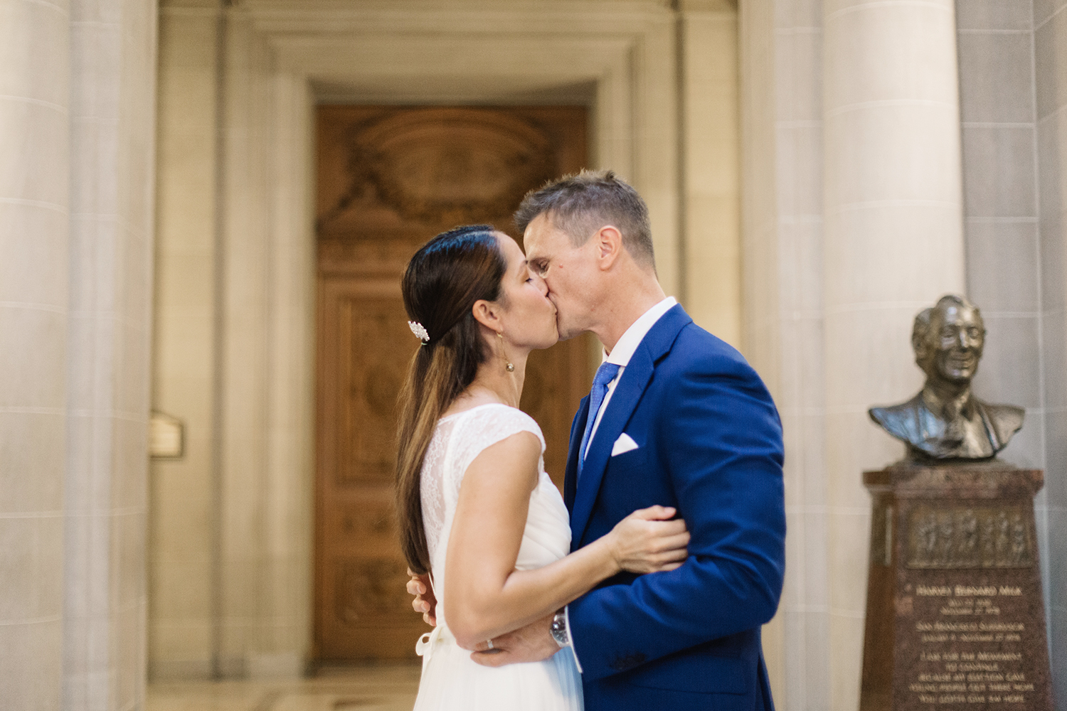 Bride and groom kissing during their wedding in San Francisco City Hall.