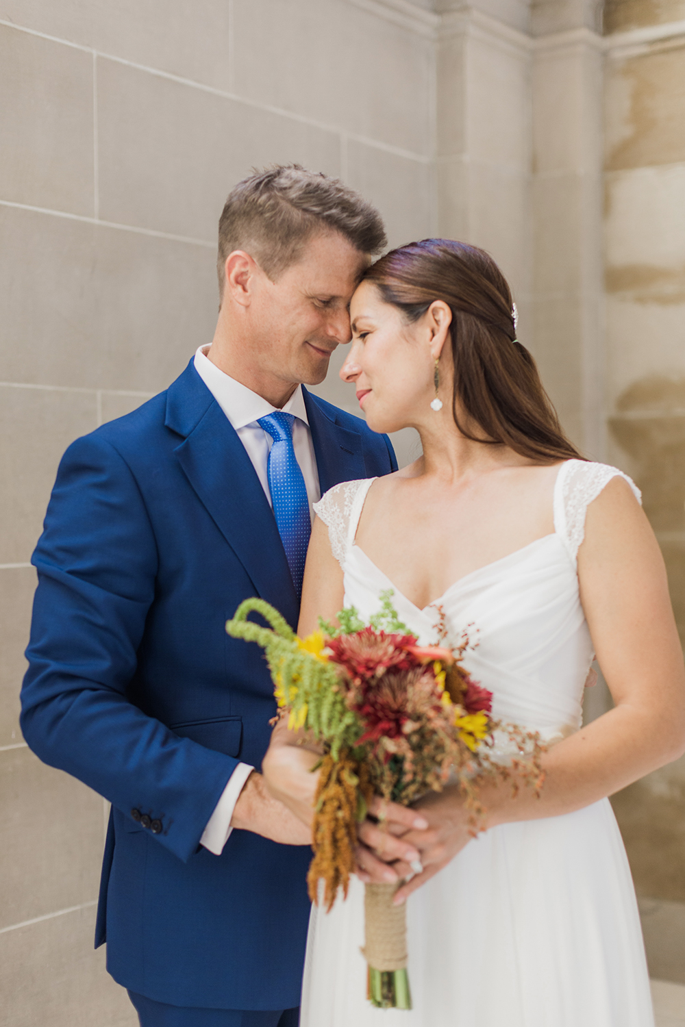 Bride and groom portraits after eloping in San Francisco City Hall