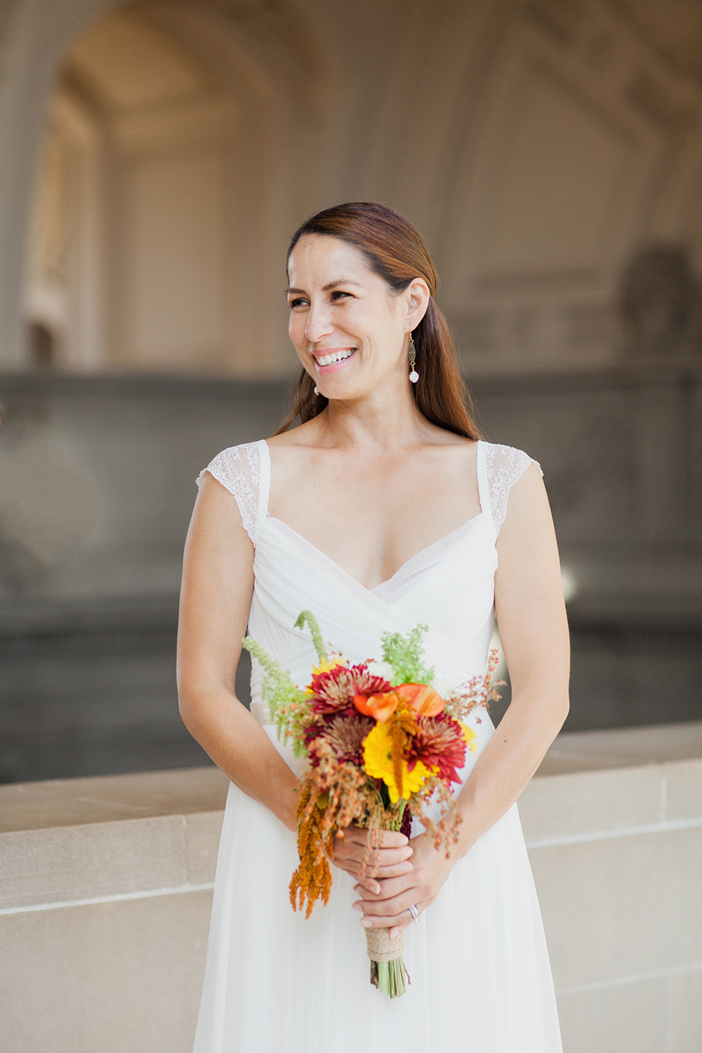 Portrait of bride during her wedding in San Francisco City Hall.