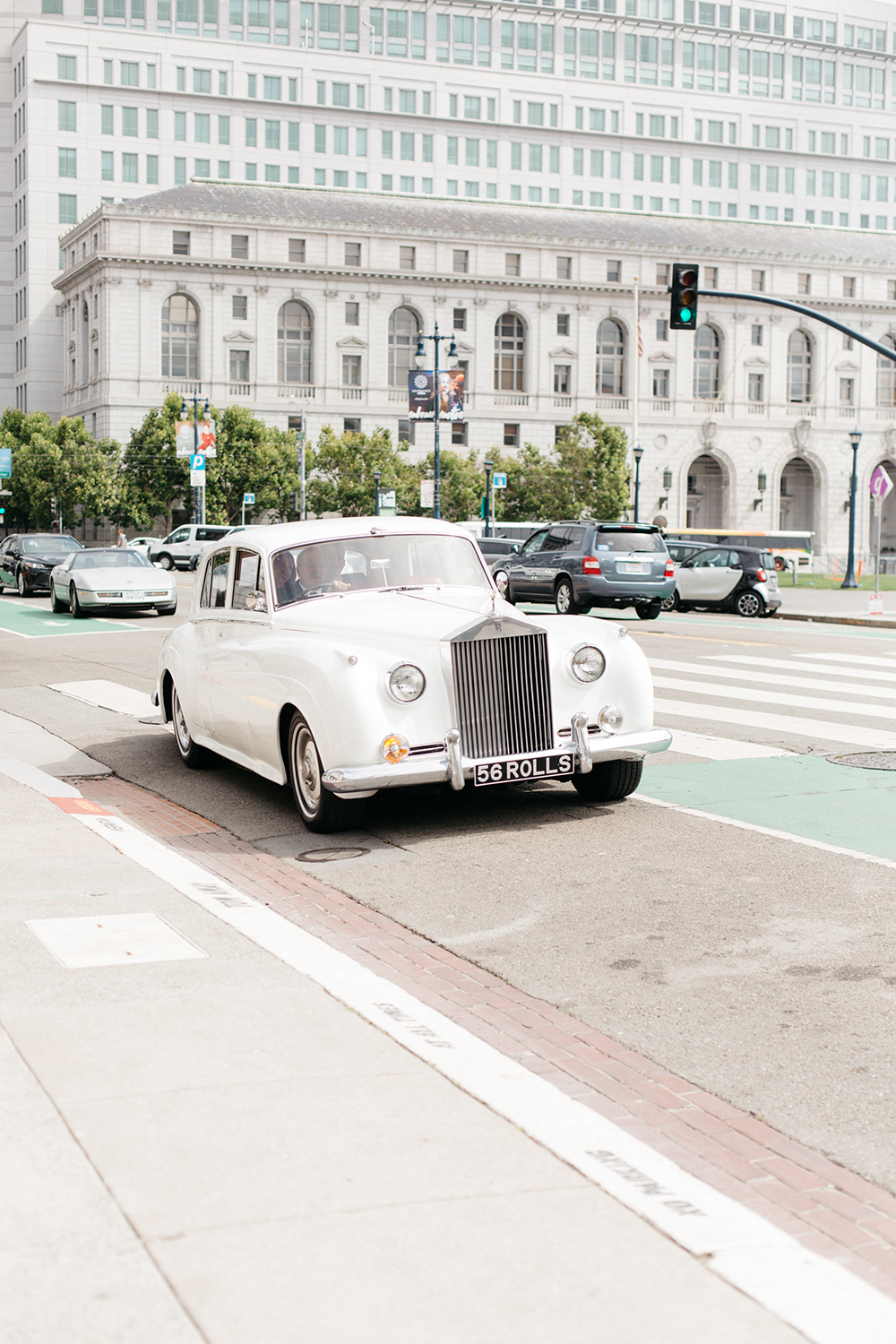Chris and Claire's arriving in Rolce Royce to their San Francisco City Hall wedding.