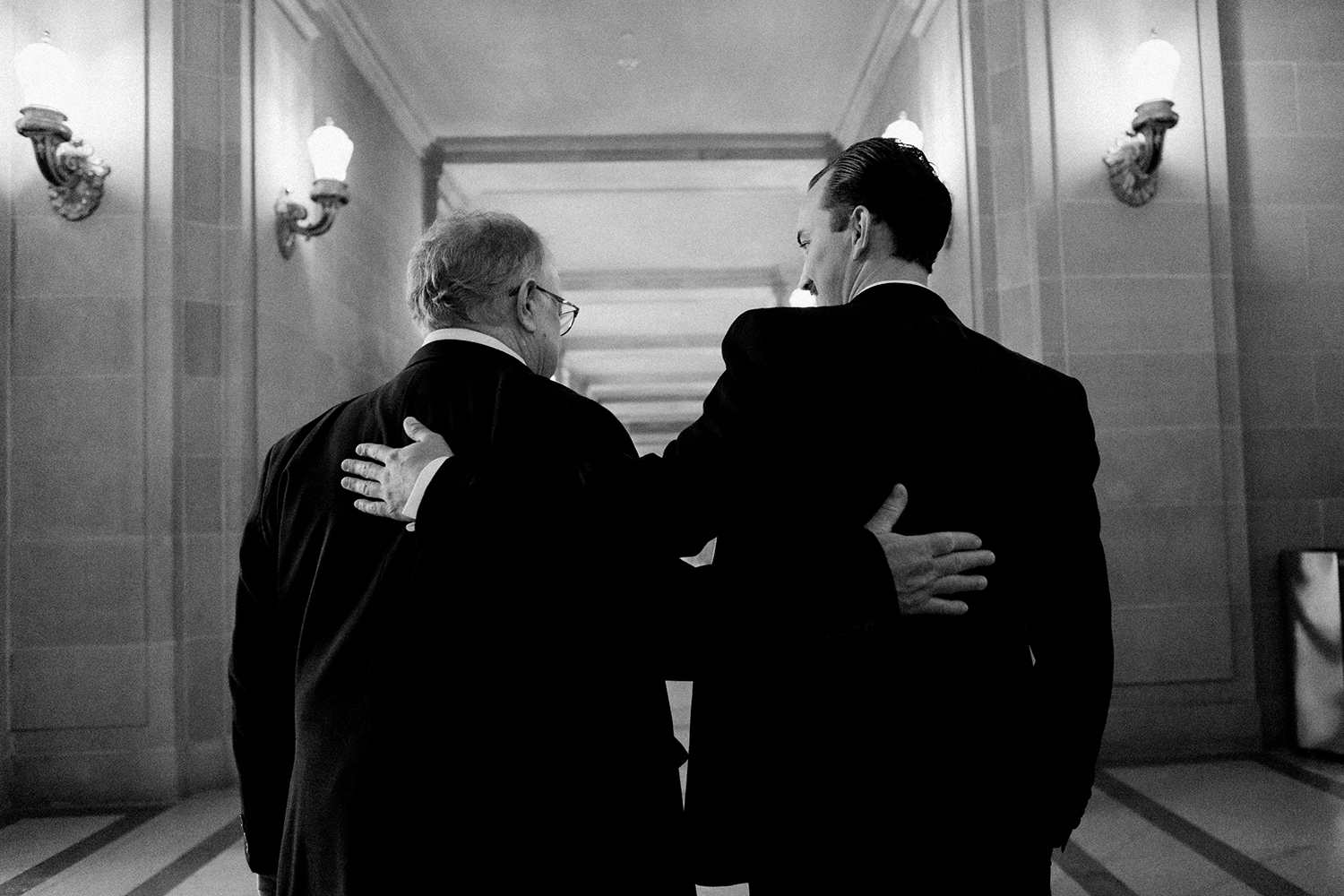 Groom walking with his father at his wedding in San Francisco City Hall.