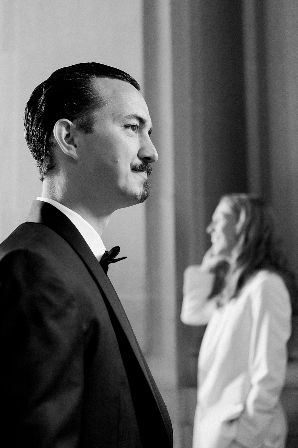 Fine art portrait of bride and groom at their wedding in San Francisco City Hall.