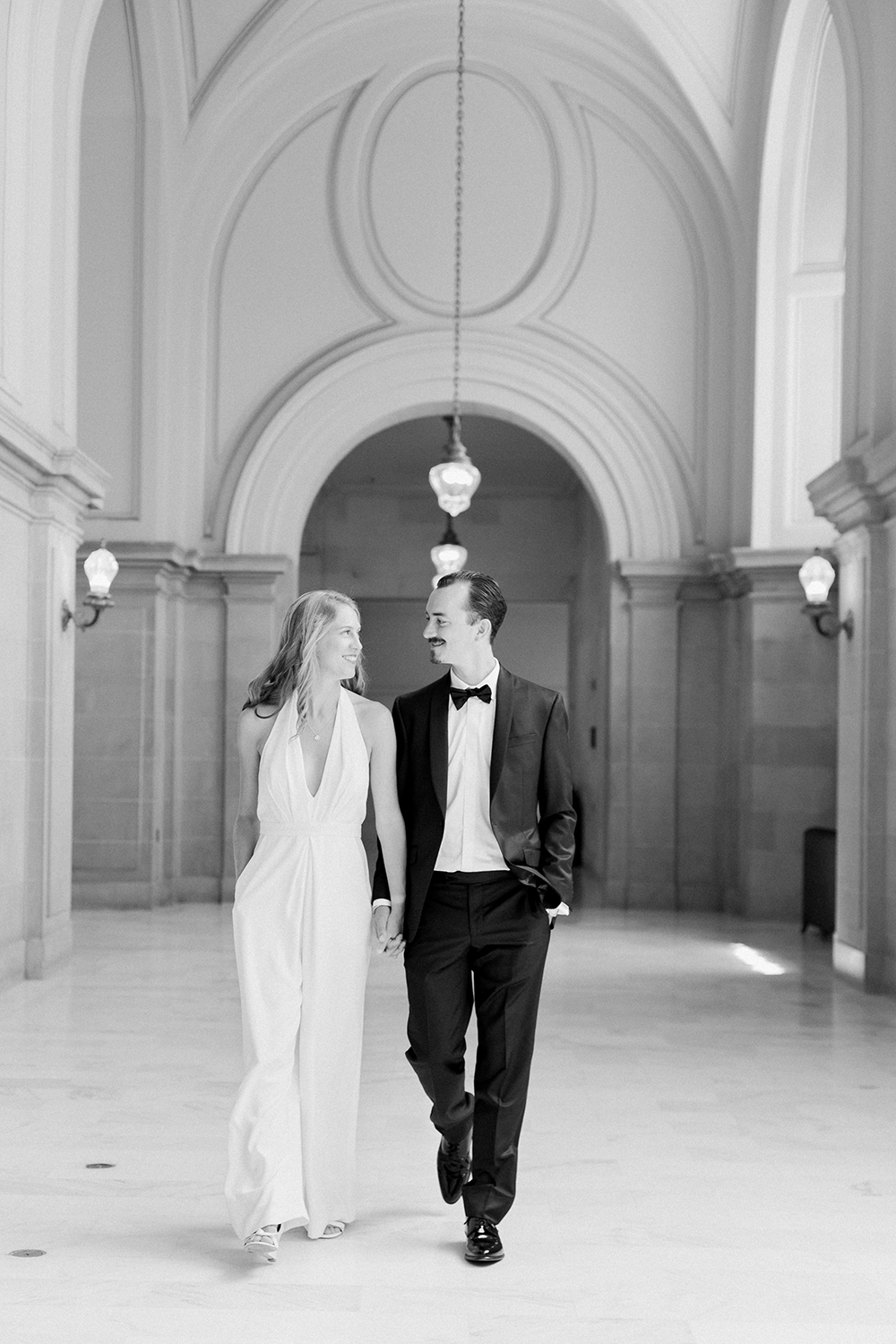 Classic black & white portraits of bride and groom during their San Francisco City Hall wedding.
