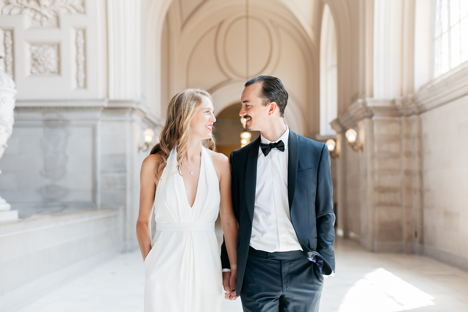 Classic portrait of simple bride and groom during their San Francisco City Hall wedding.