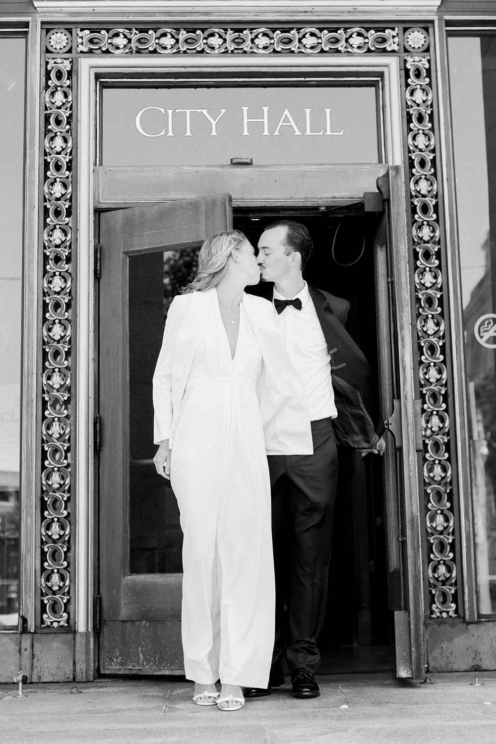 Classic portraits of bride and groom during their San Francisco City Hall wedding.