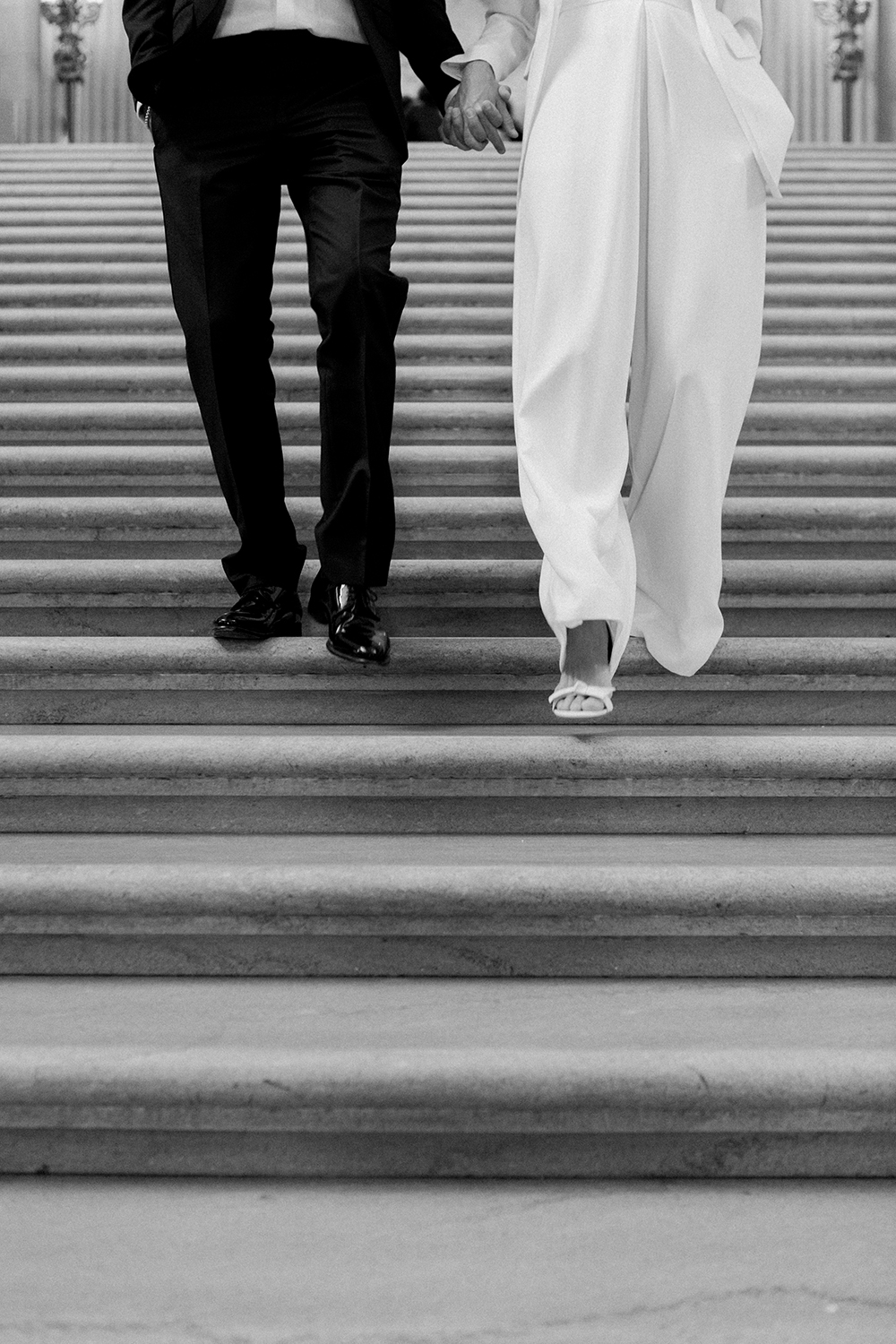 Classic portraits of bride and groom walking during their San Francisco City Hall wedding.