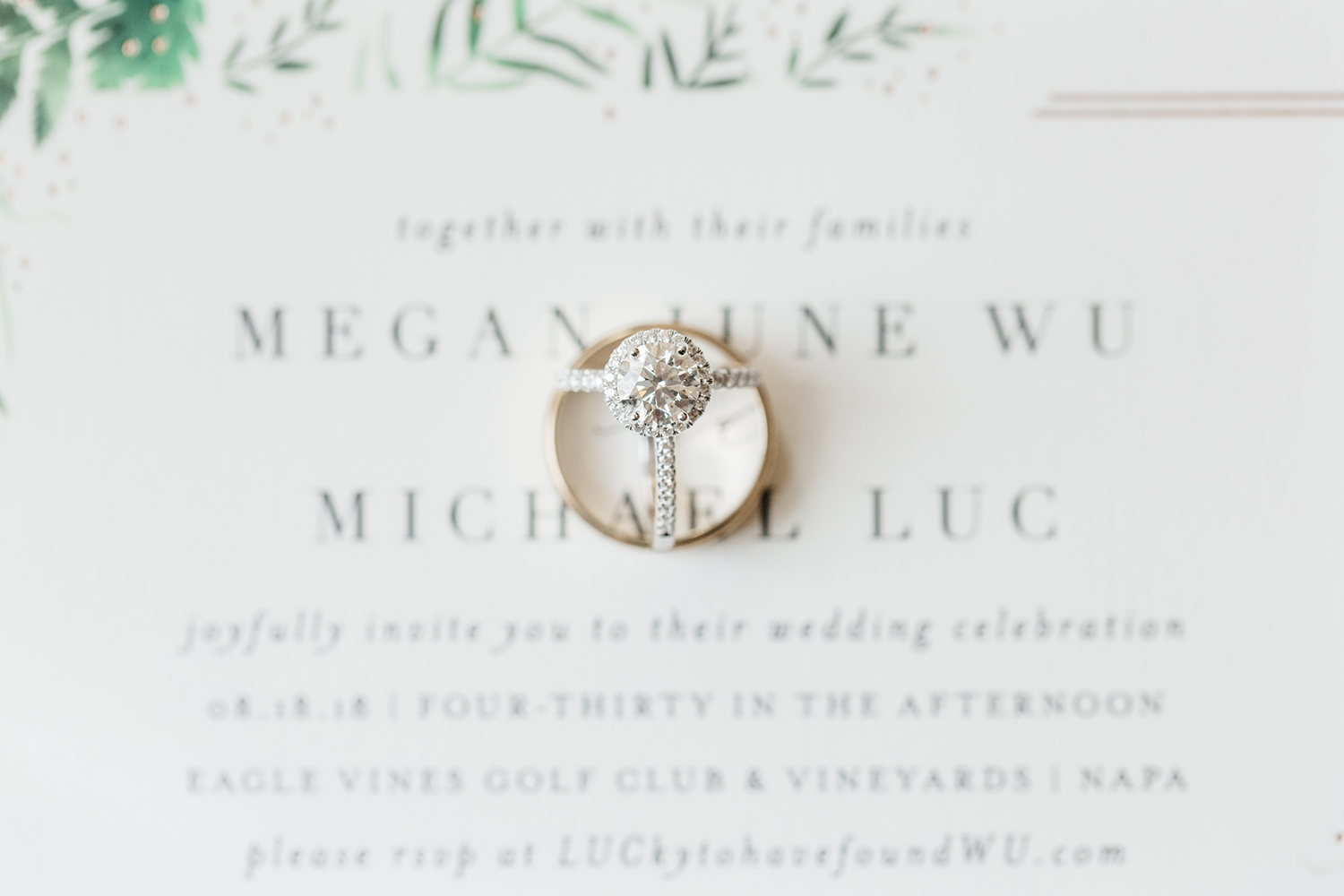 wedding photography of invitation and rings from a wedding at eagle vines golf club in napa california