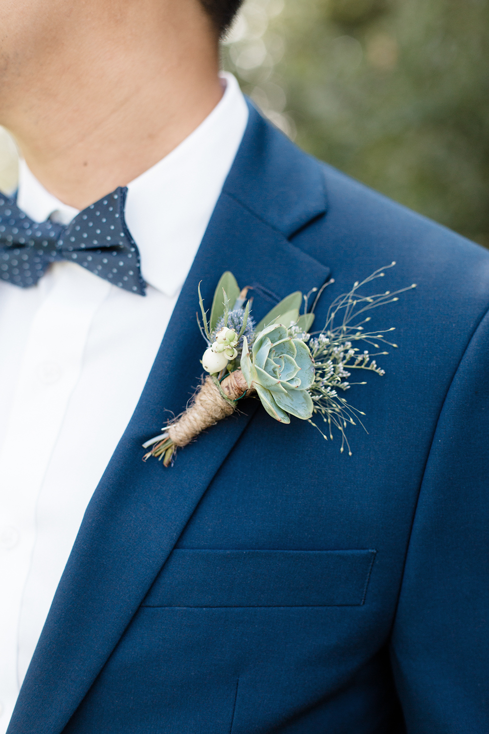 wedding photography of groom boutonniere at eagle vines golf club in napa california