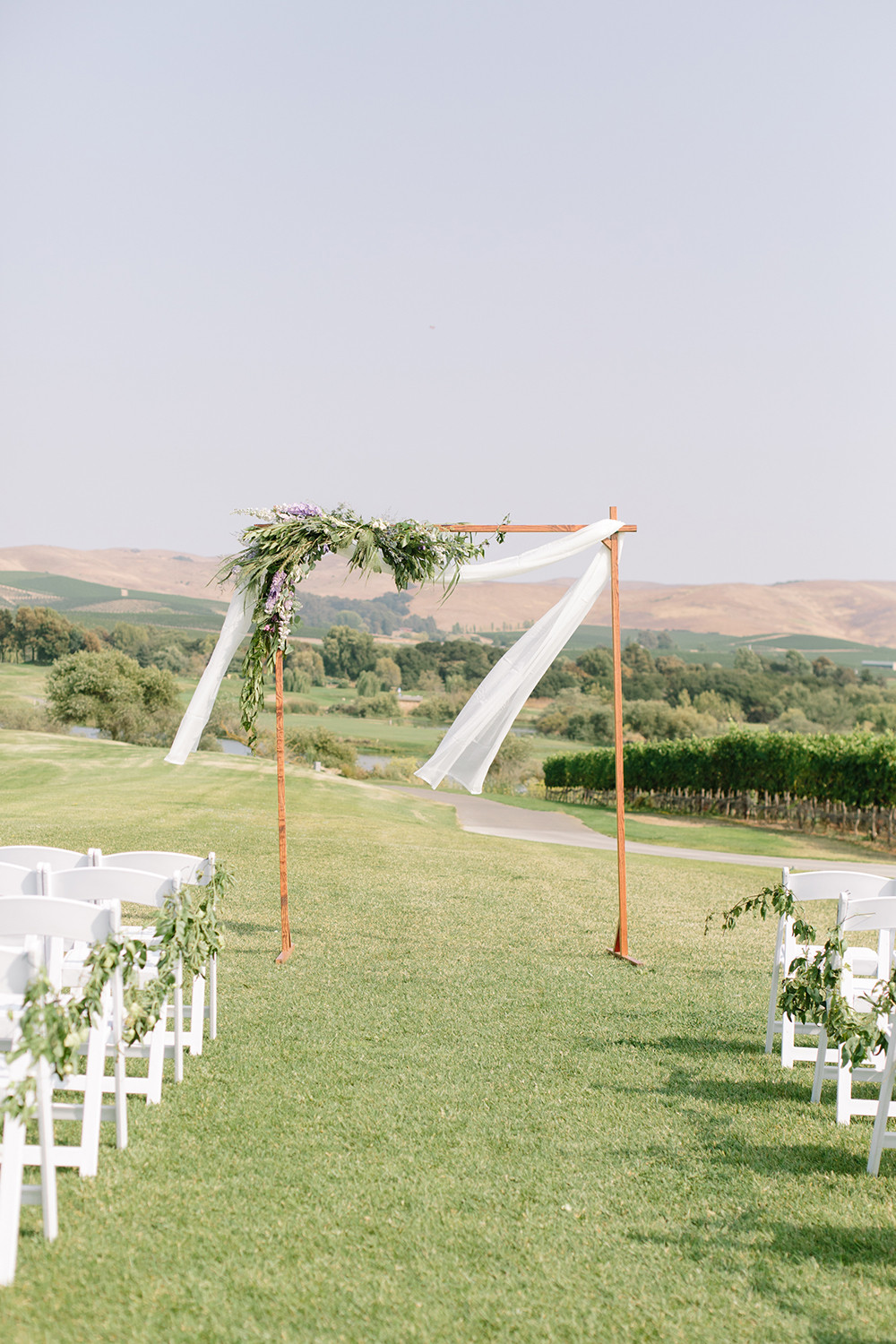 wedding photography of ceremony floral arch at eagle vines golf club in napa california