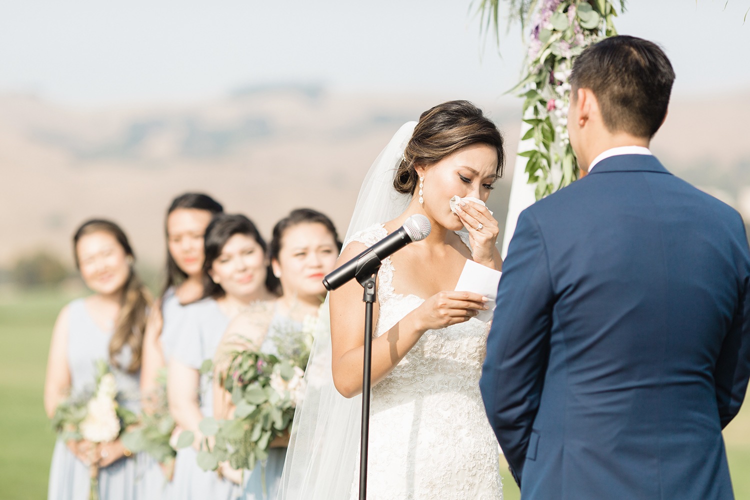 wedding photography of bride crying while reading vows at eagle vines golf club in napa california