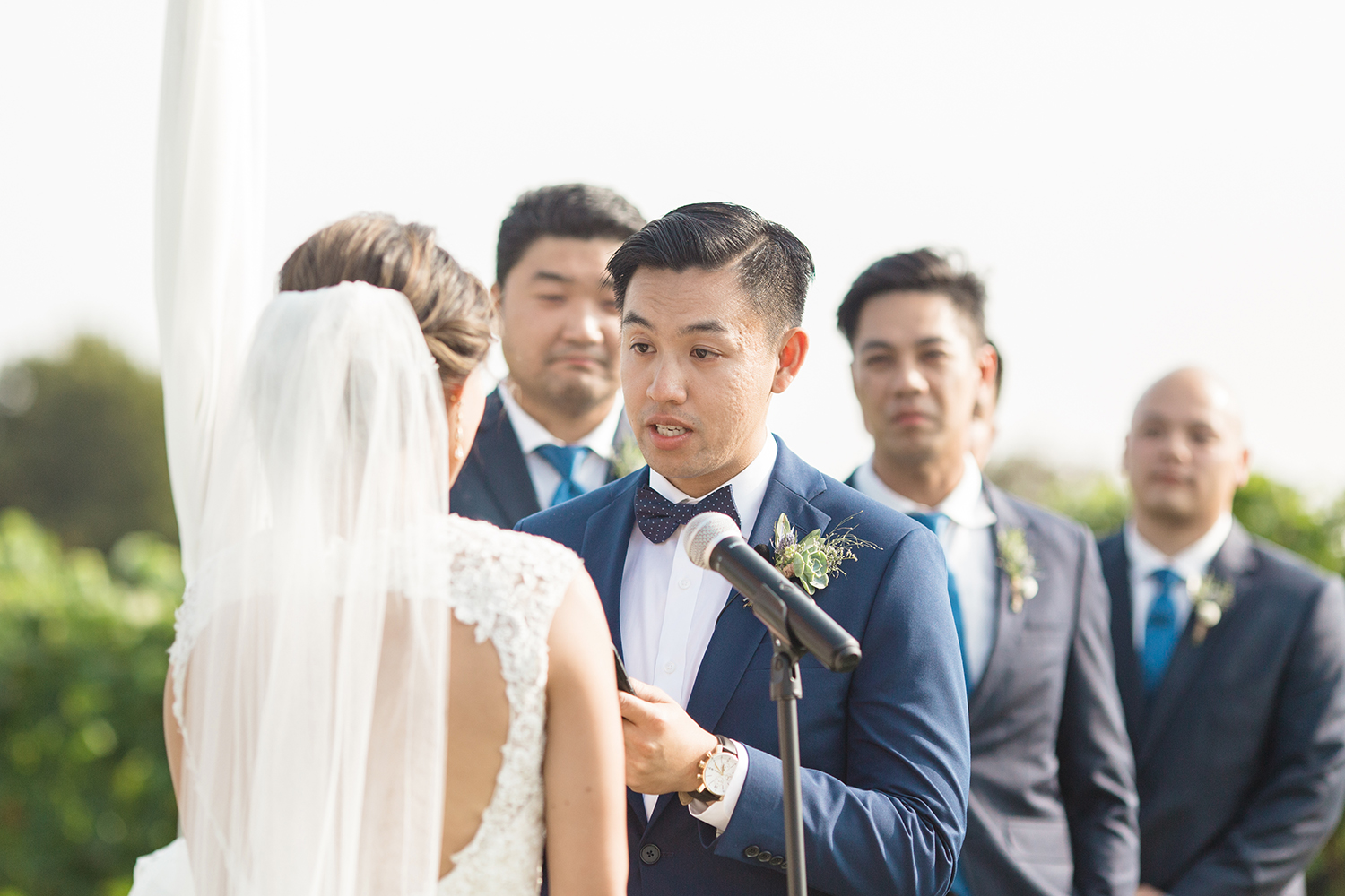 wedding photography of groom reading vows at eagle vines golf club in napa california