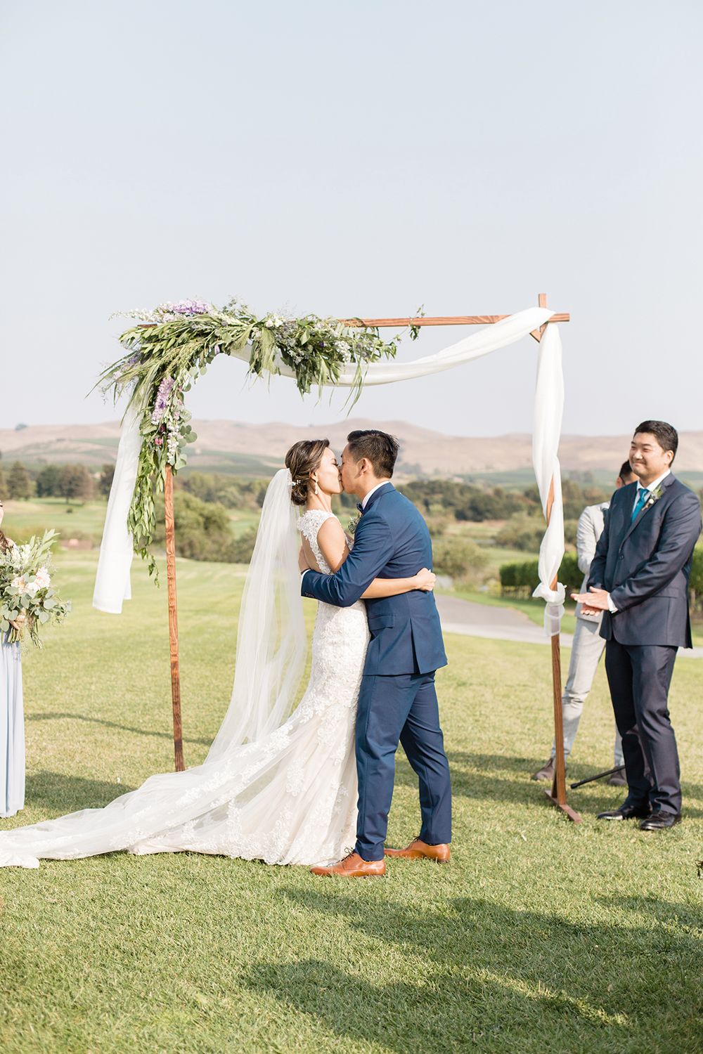 wedding photography of groom kissing bride at eagle vines golf club in napa california