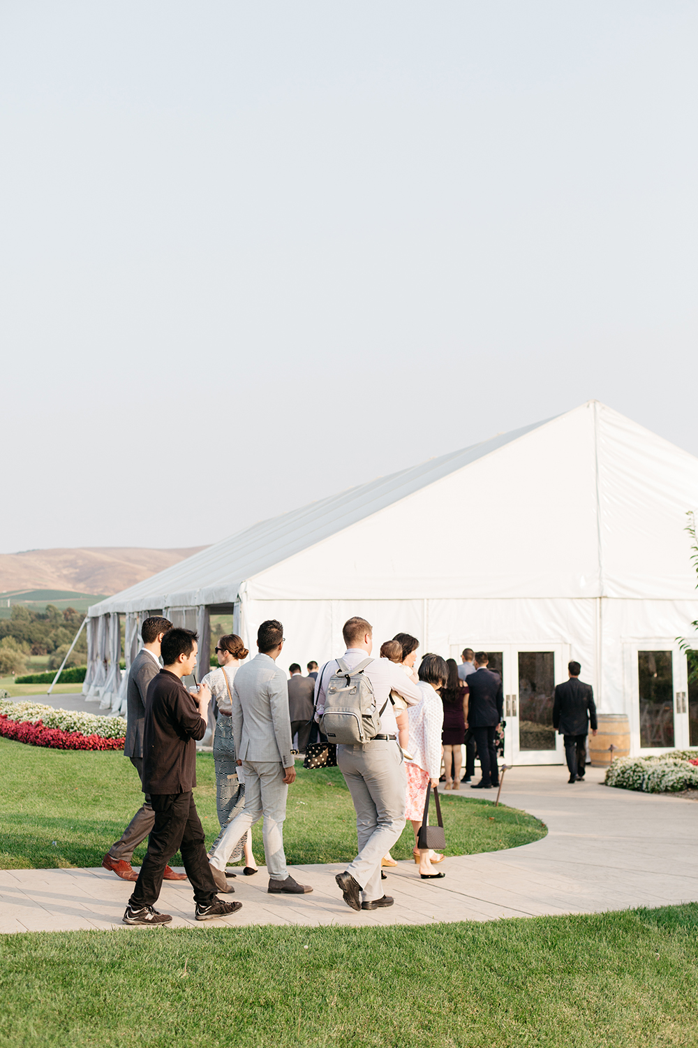 wedding photography of guests walking to reception at eagle vines golf club in napa california