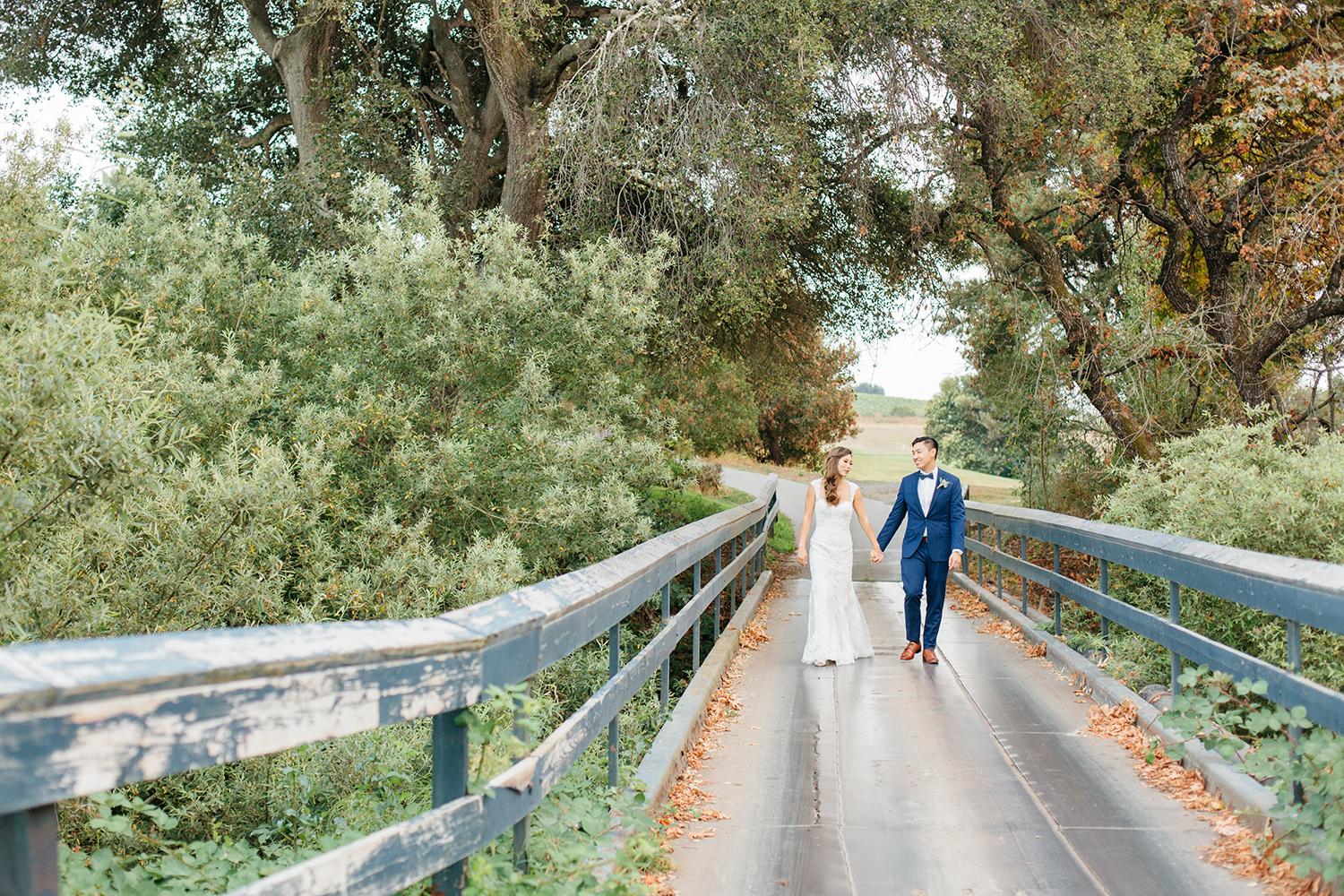 wedding photography of bride and groom walking at eagle vines golf club in napa california
