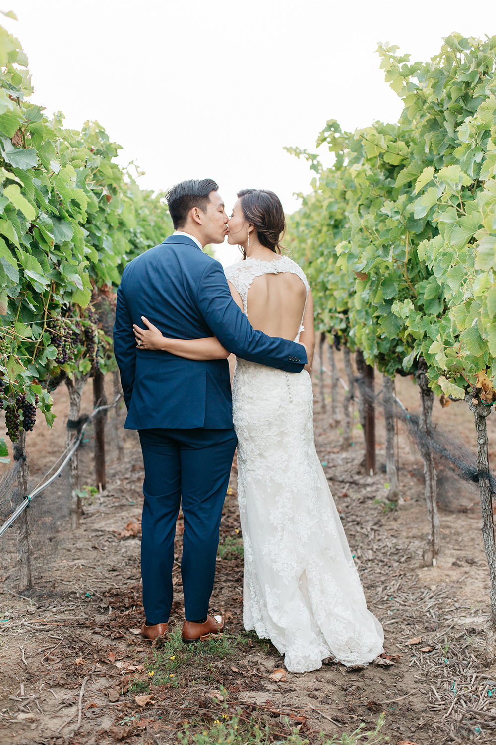 sunset portraits of bride and groom in vineyard wedding at eagle vines golf club in napa california