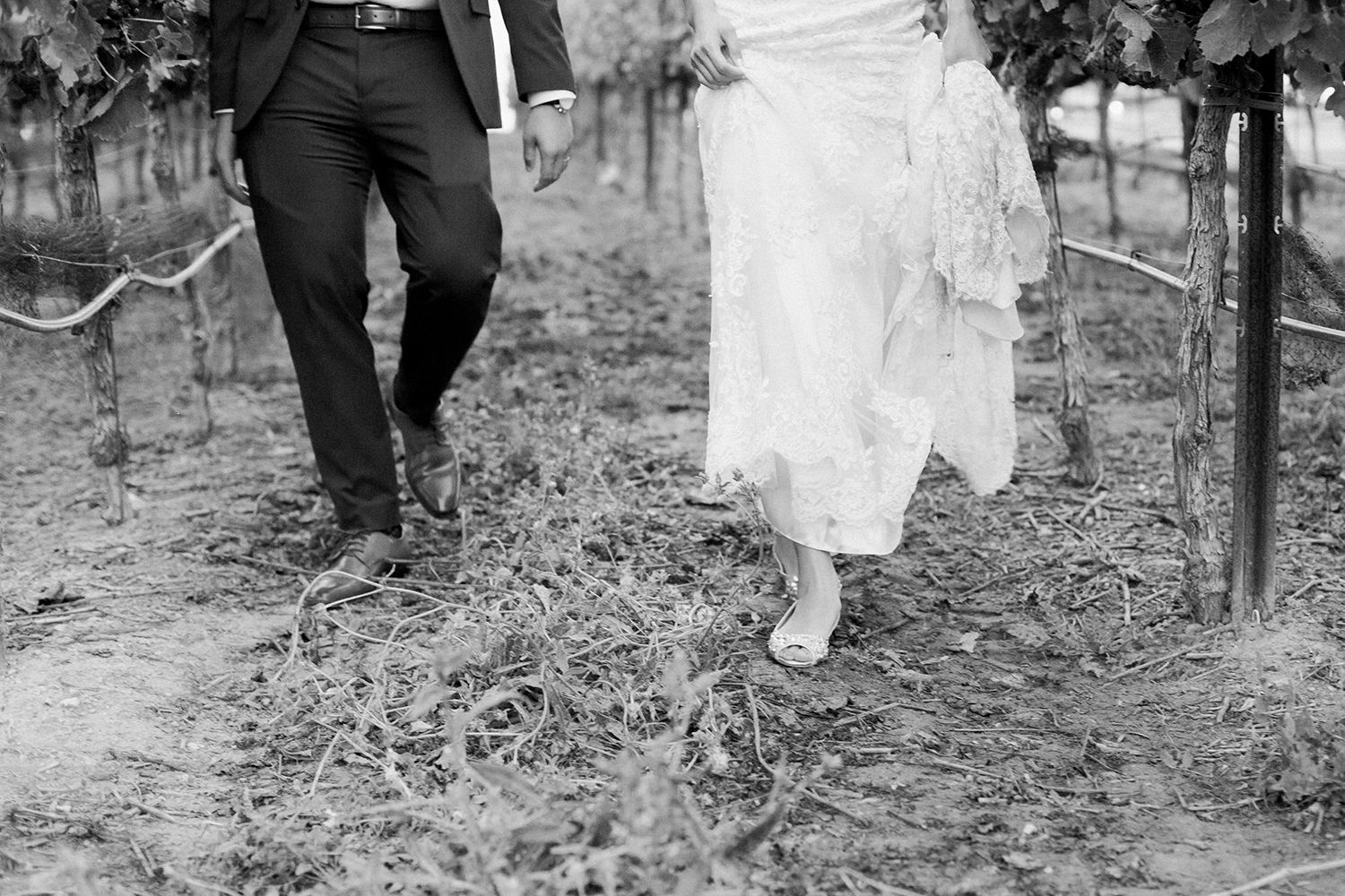 candid portrait of bride and groom in vineyard wedding at eagle vines golf club in napa california