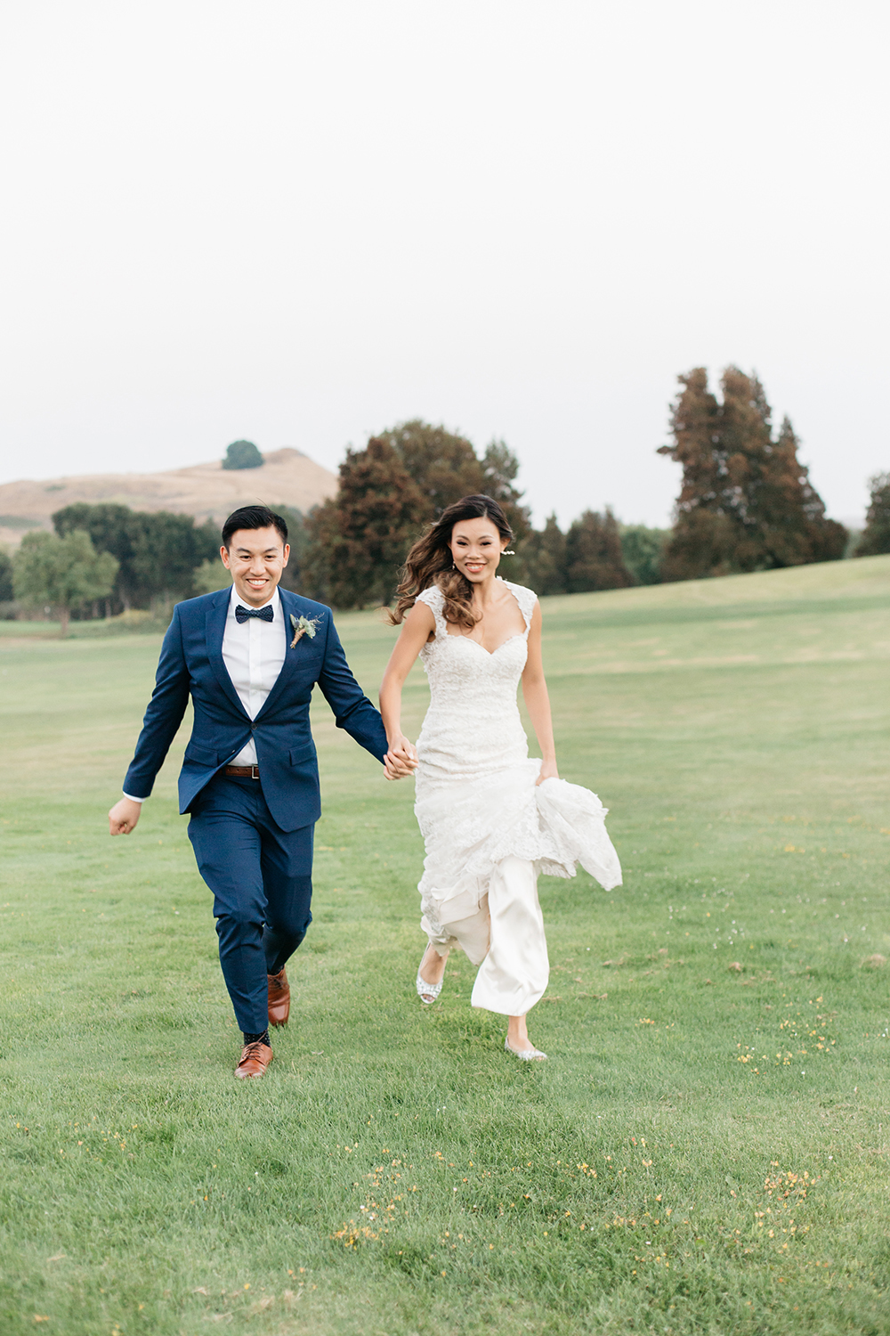 bride and groom running on their wedding at eagle vines golf club in napa california